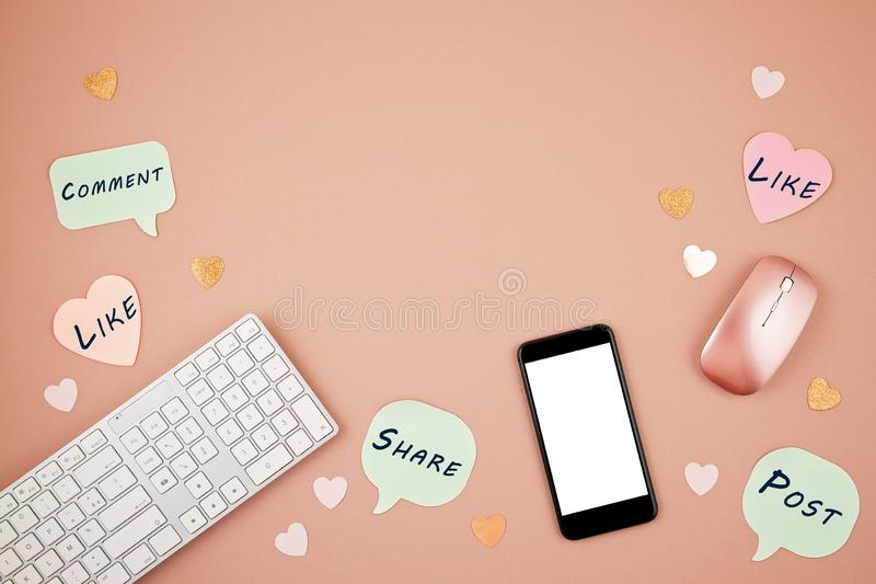 Social media concept flatlay with keyboard, phone, mouse royalty free stock image