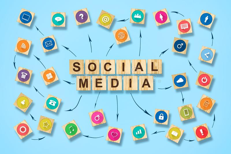 Social media concept with social icons on wooden blocks. Blue background stock photos