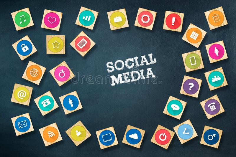 Social media concept with social icons on wooden blocks. Dark blue background.C stock images