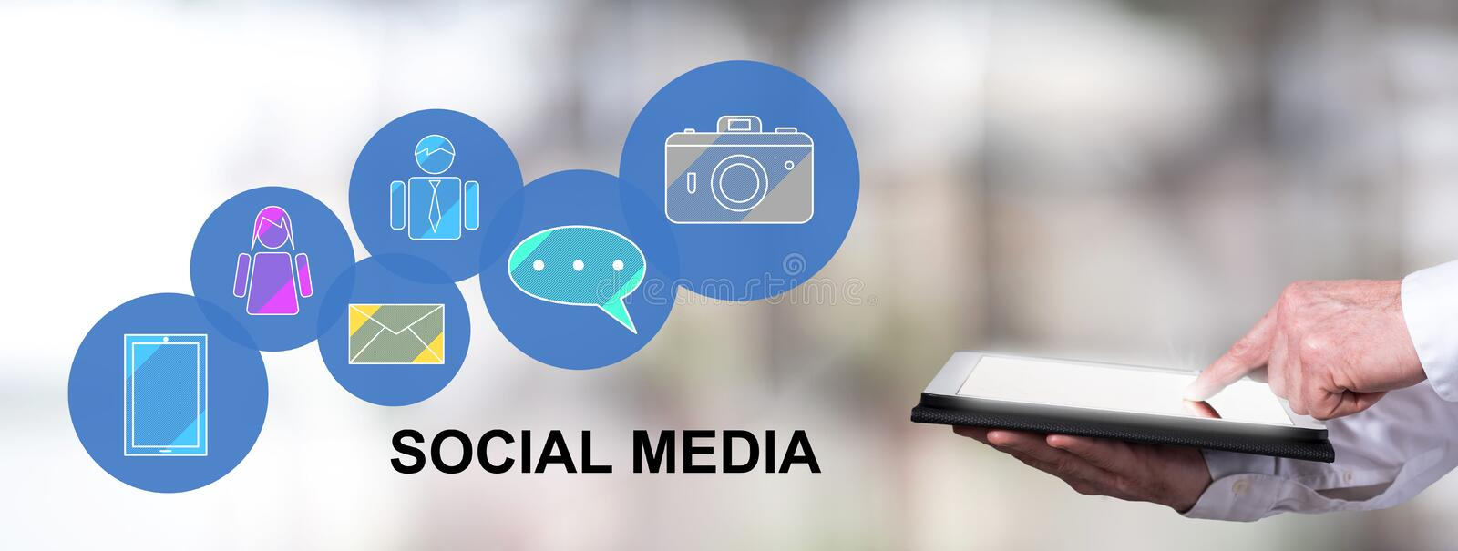 Social media concept with man using a tablet. Man using a tablet with social media concept stock images