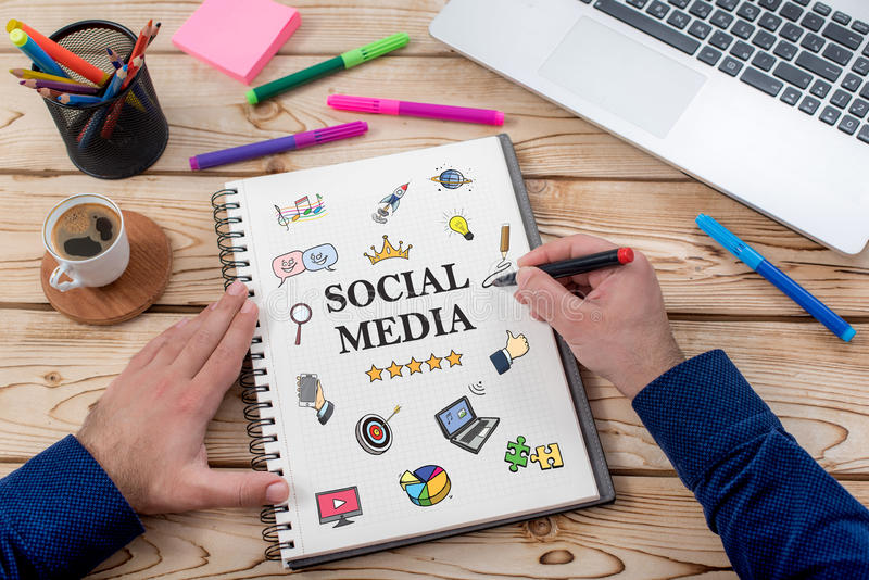 Social Media Concept On Work Desk With Various Doodle Icons royalty free stock photos