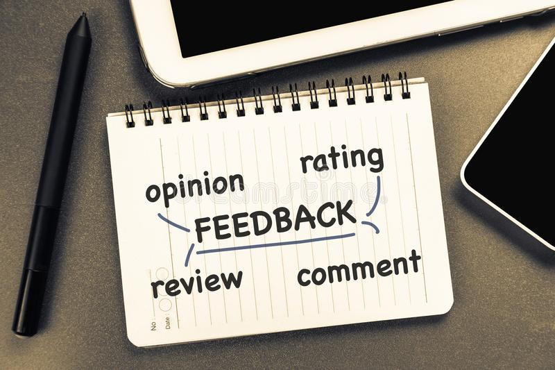 Feedback Social. Social media feedback concept with tablet and smart phone royalty free stock photos