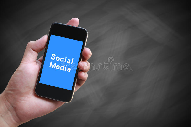 Social Media. Hand holding smartphone with text Social Media