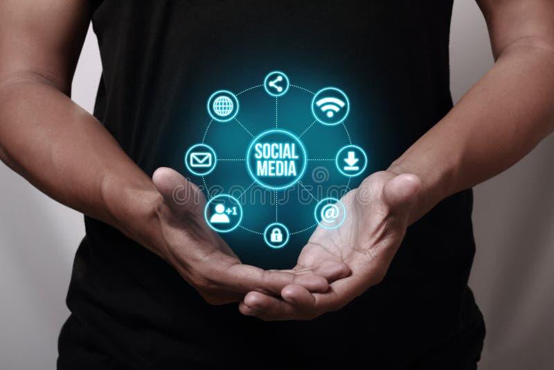 Social Media. Hand showing social media icons