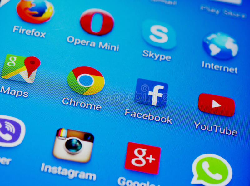 Social media icons. On screen of smartphone stock photo