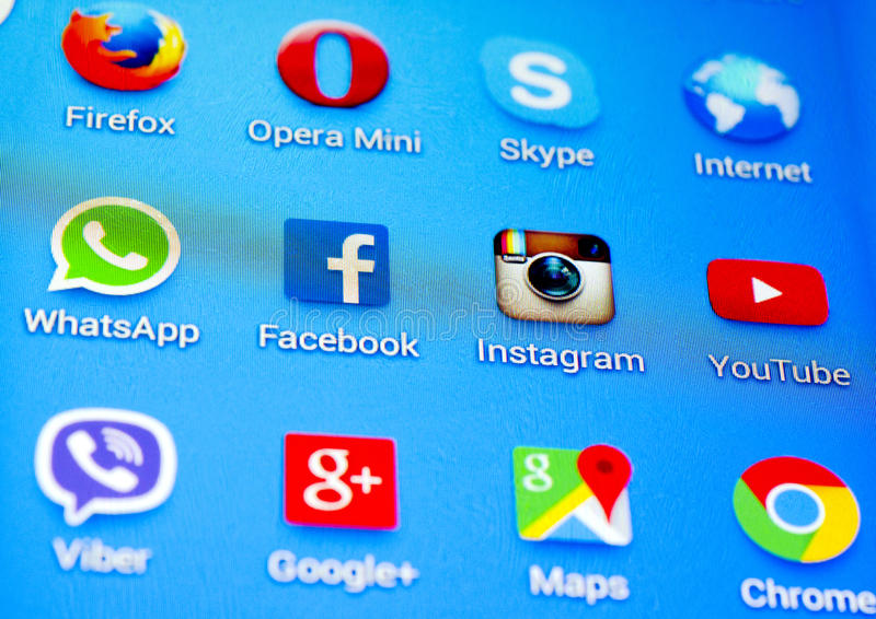 Social media icons. On screen of smartphone stock images