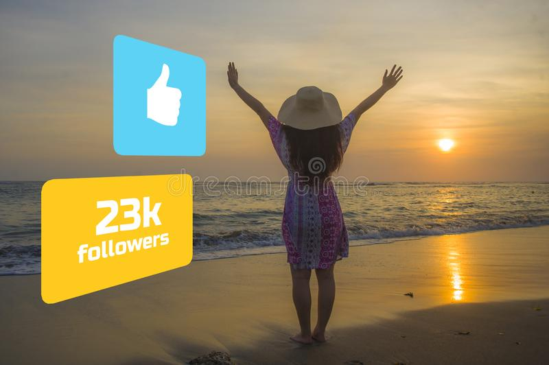 Social media influencer girl in enjoying summer sunset in paradise beach . young happy woman feeling free getting likes and royalty free stock photo