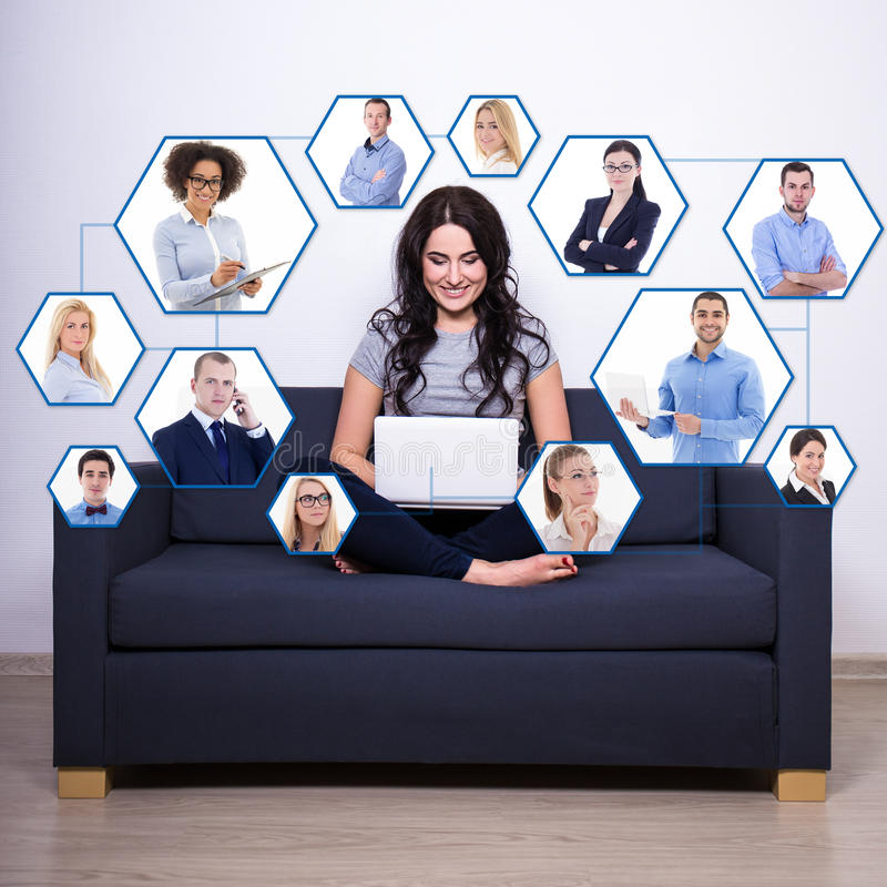 social media and internet addiction concept - pretty woman sitting on sofa and using laptop at home royalty free stock images