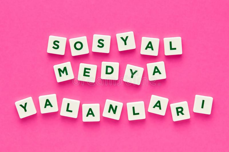 Social media lies written with letters on pink background royalty free stock photos