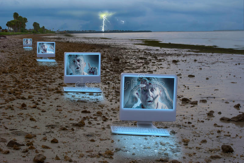 Download Four Computers On A Dark Stormy Beach Stock Photo - Image: 27227852