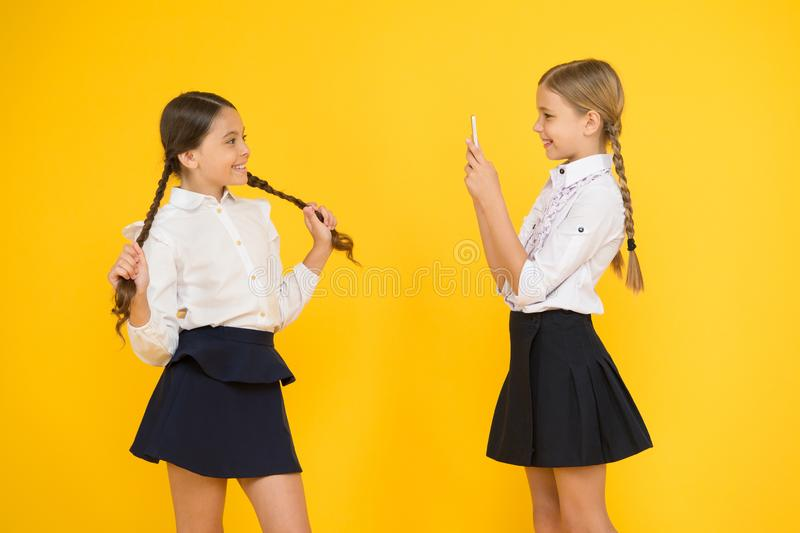 Social media marketing. Modern technology. Digital influencer. Little blogger. Blogger school. Schoolgirls bloggers use. Smartphone take photo. Application royalty free stock photo