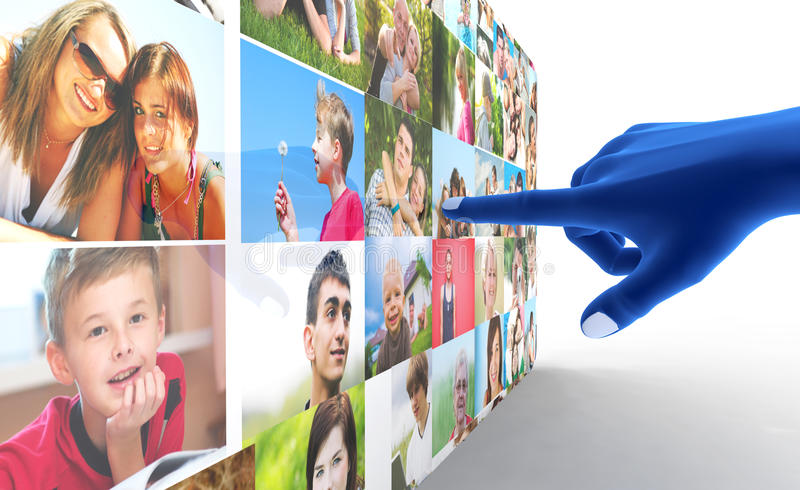 Social media network. Blue hand pointing at screen full of people, faces stock photo