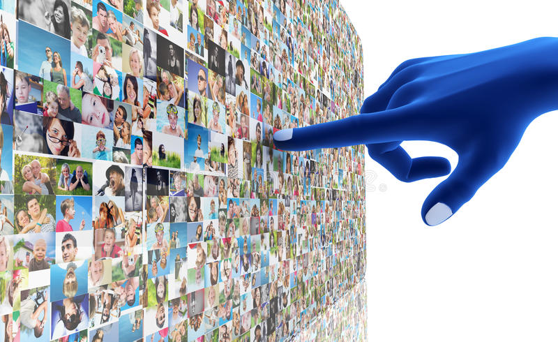 Social media network. Blue hand pointing at screen full of people, faces stock images