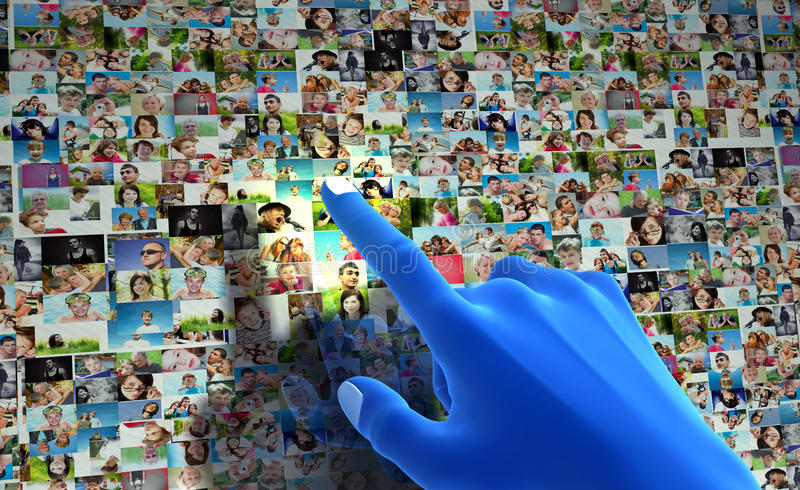 Social media network. Blue hand pointing at screen full of people, faces royalty free stock images