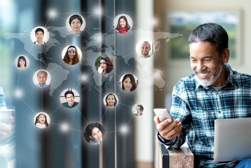 Social media network,  Global network connection and people connecting all over the world map. Smiling happy mature man using royalty free stock photos