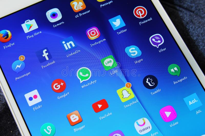 Social media networks applications icons. Logos and icons of social media networks applications on tablet screen royalty free stock photography