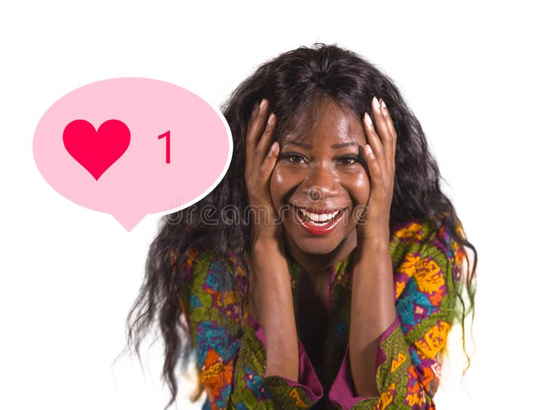 Social media obsession . young crazy happy and excited black afro American woman celebrating one single online like on internet stock photo