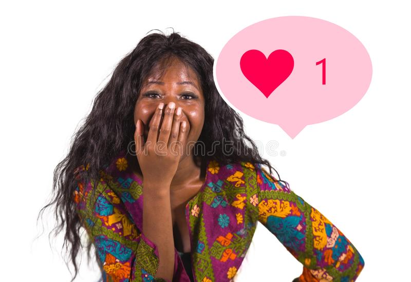 Social media obsession . young crazy happy and excited black afro American woman celebrating one single online like on internet stock photos