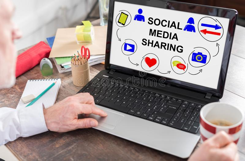 Social media sharing concept on a laptop screen stock photo