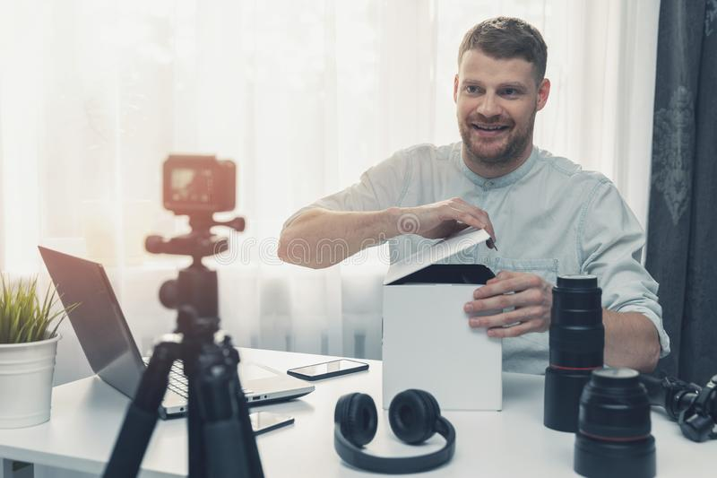 social media technology influencer recording unboxing video royalty free stock photo