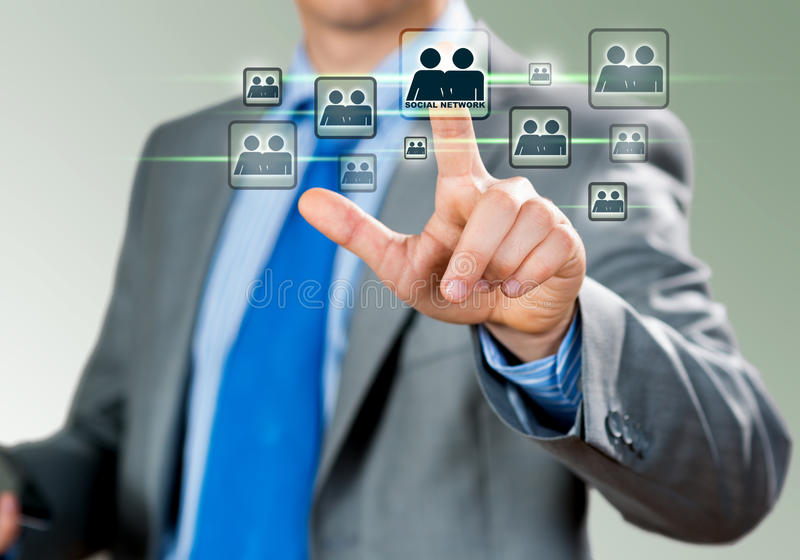 Social network. Close up of businessman hand touching icon of media screen stock photo