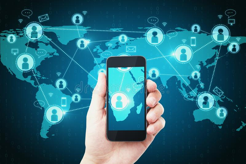 Social network and connection concept. Hand holding smartphone with glowing map and digital icons. Social network and mobile connection concept stock photos