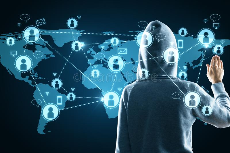 Social network and hacking concept. Hacker in hoodie using glowing map with connections. Social network and hacking concept stock photos