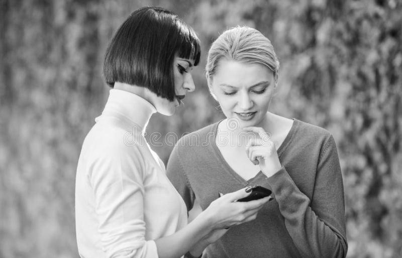 Social network. just look at this. 3g 4g mobile internet surfing. digital marketing two happy women look in phone. buy. Online on cyber monday. black friday stock image