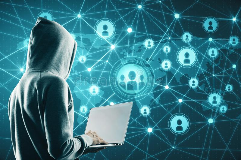 Social network and malware concept. Hacker using laptop with glowing connections on blue digital map royalty free stock photos