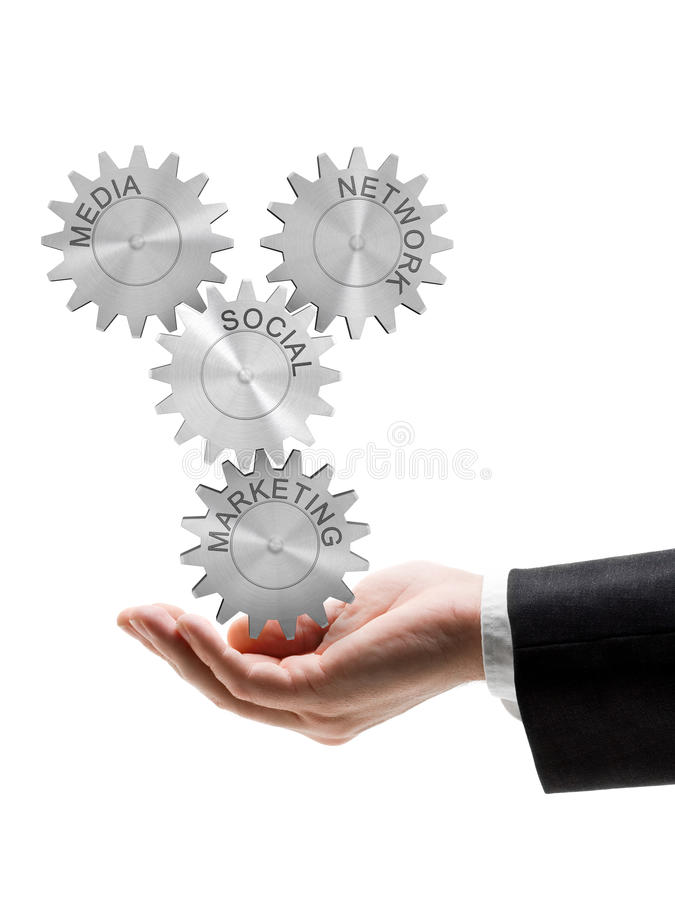 Social network, media and marketing. Business man holding gear wheel concept of social network, media and marketing