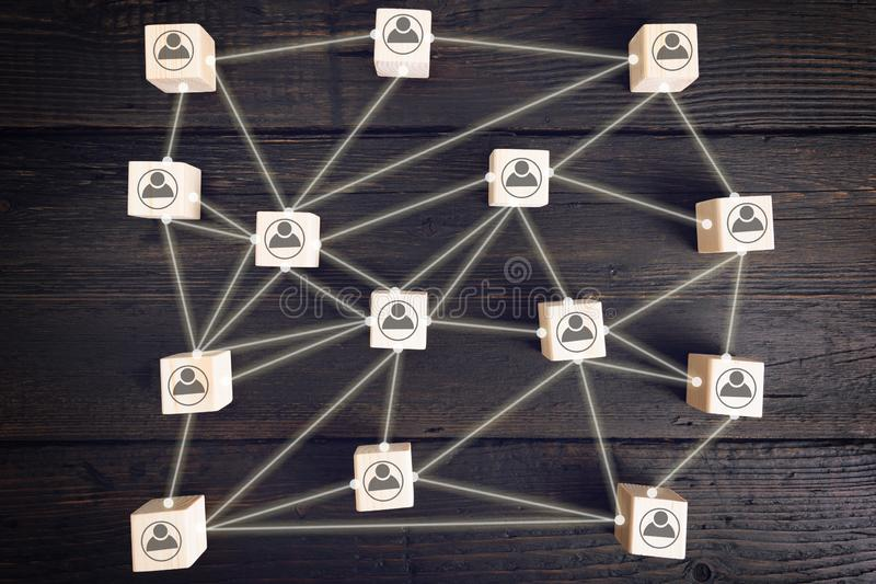 Social network scheme, which contains business people icons connected to each other. Human resource management. Looking for royalty free stock images