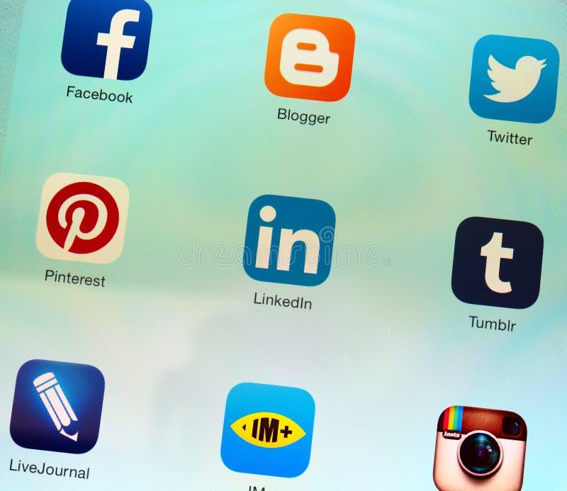 Social networking applications on Apple iPad retina display. SIMFEROPOL, RUSSIA - JULY 17, 2014: Social networking applications on an Apple iPad Air retina stock images