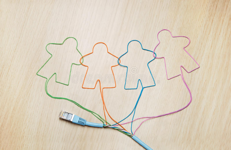 Social networking. Ethernet cable shaping silhouettes of virtual users