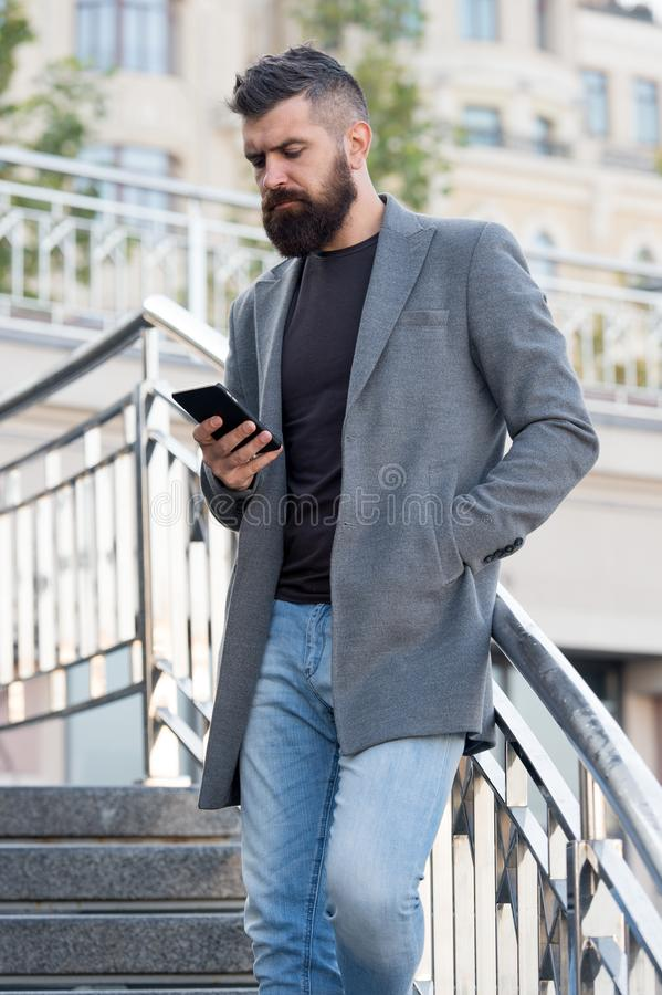 Social networks dependence. Busy man use mobile phone outdoors. Social media time tracker provide detailed information. How many times day pick smartphone stock image