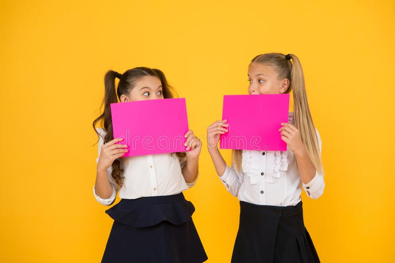 Social poster copy space. Socialization involves how children get along with each other. Visual communication concept. School friendship. Girls school uniform royalty free stock image