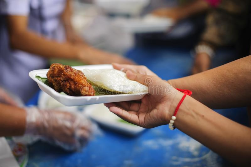 Social Problems of Poverty Helped by Feeding : Concepts problems of life the poor : Volunteers Share Food to the Poor to Relieve royalty free stock images