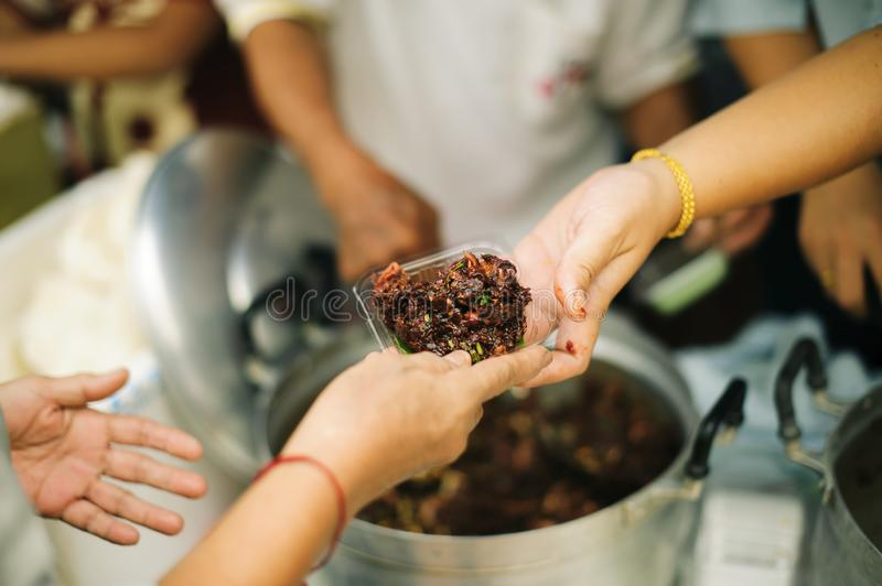 Social Problems of Poverty Helped by Feeding : Concepts problems of life the poor : Volunteers Share Food to the Poor to Relieve royalty free stock photos