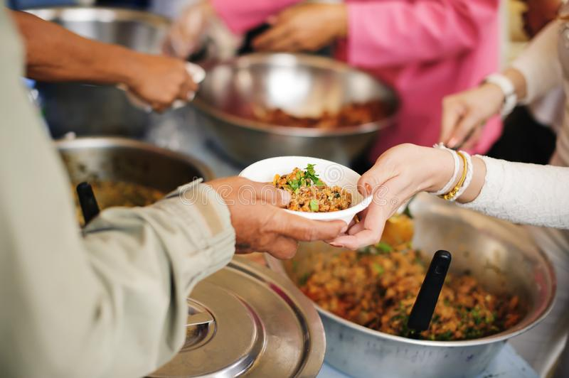 Social Problems of Poverty Helped by Feeding : Volunteer to Feed the Hungry in Society: The Concept of Donating Food to the Poor royalty free stock images