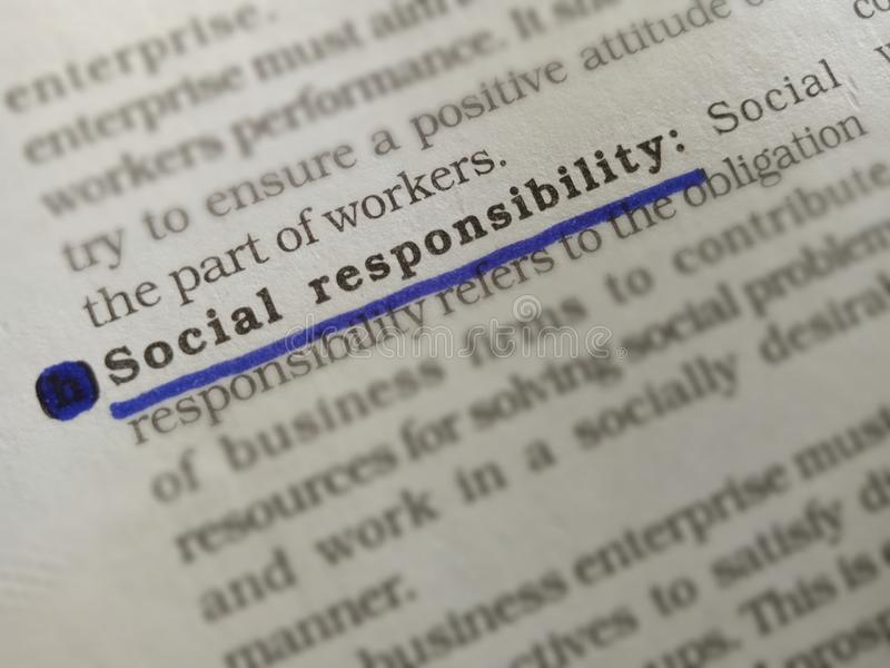 Social responsibility word displayed on white paper sheet with underlined text form. Government, , written, book, article, pattern, life, financial stock photo