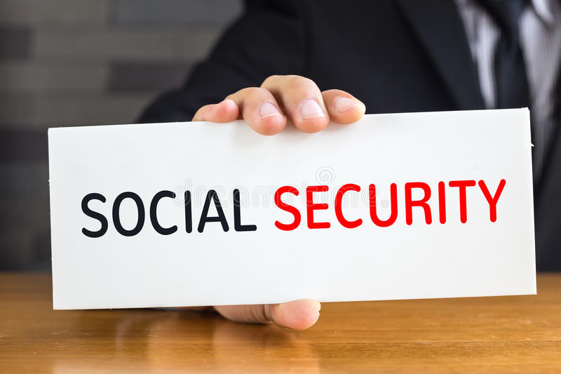 Social security, message on white card and hold by stock image