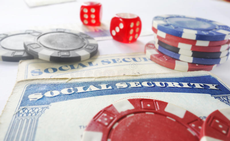 Social Security risk concept. Social Security cards with dice and poker chips royalty free stock photo