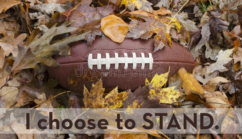 I choose to stand for the national anthem before a football game. Social and sports issue - league football players choosing to sit or kneel for the national royalty free stock images