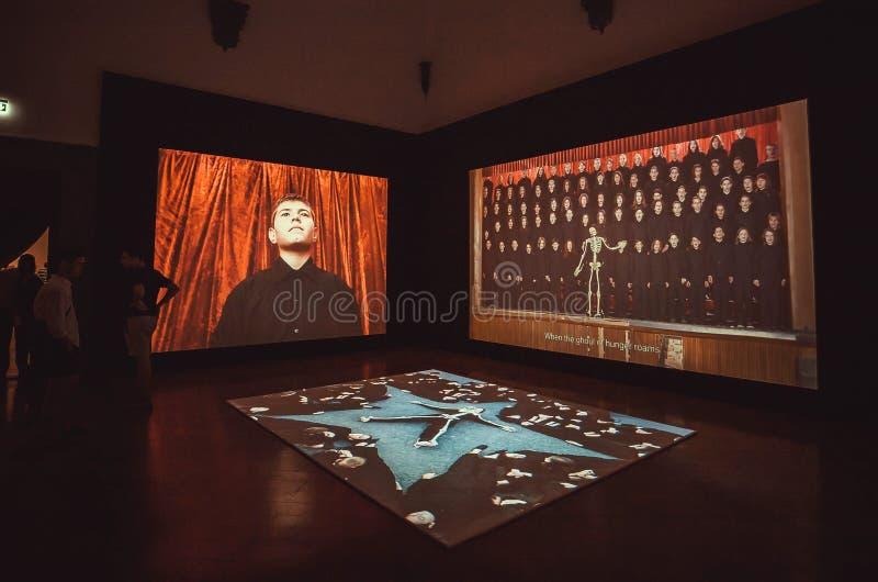 Social theme video installation in contemporary exhibition of artist Marina Abramovic. FLORENCE, ITALY - SEPT 25: Social theme video installation in contemporary stock photos