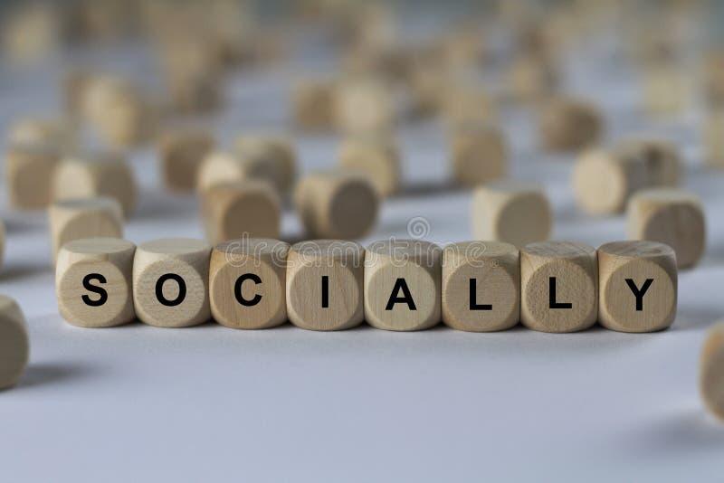 Socialement - cube avec des lettres, signe avec les cubes en bois photos libres de droits