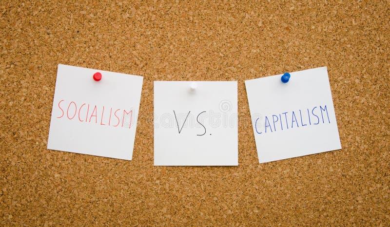 Socialism vs kapitalism royaltyfri fotografi