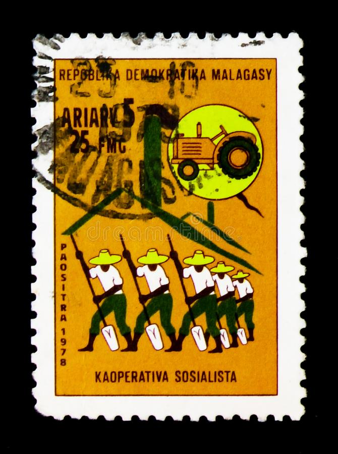 Socialist cooperative, serie, circa 1978. MOSCOW, RUSSIA - JANUARY 2, 2018: A stamp printed in Madagascar shows Socialist cooperative, serie, circa 1978 royalty free stock image
