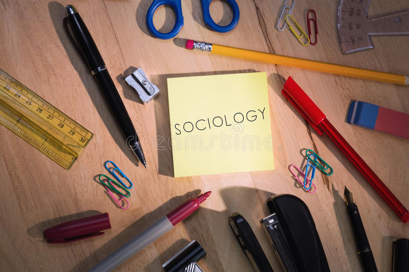 Sociology against students table with school supplies. The word sociology against students table with school supplies stock photography