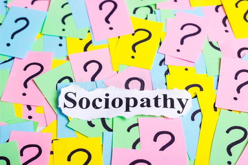 Sociopathy Syndrome text on colorful sticky notes Against the background of question marks.  stock photography