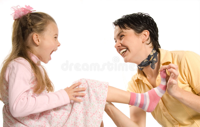 Sock dress-up. Mom and daghter having fun with dress-up royalty free stock image