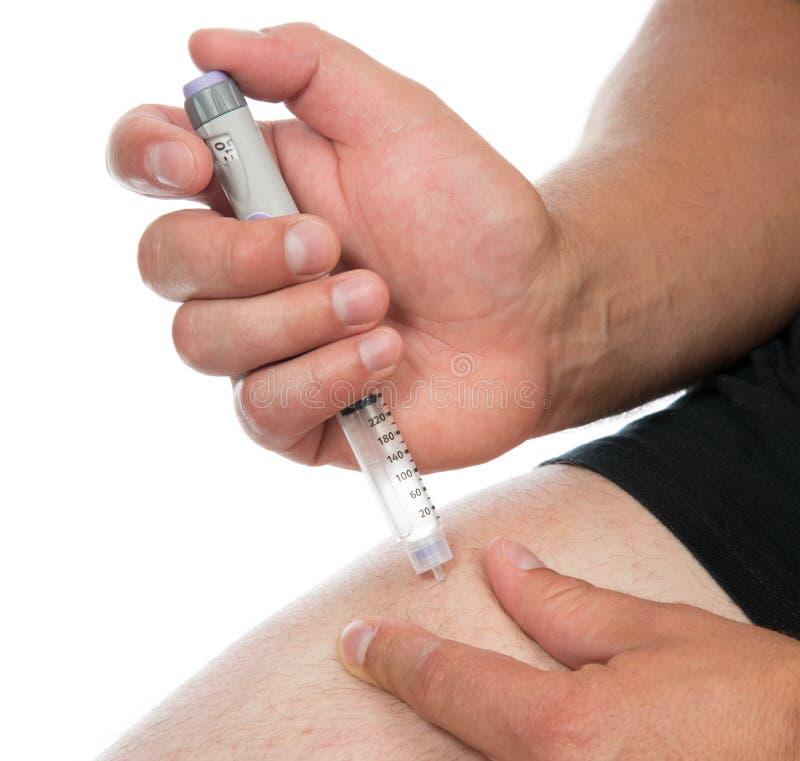 Sockersjuka som injicerar insulindosen av lantusvaccineringen arkivfoton